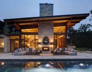 Outdoor fireplace area in a lake country home.