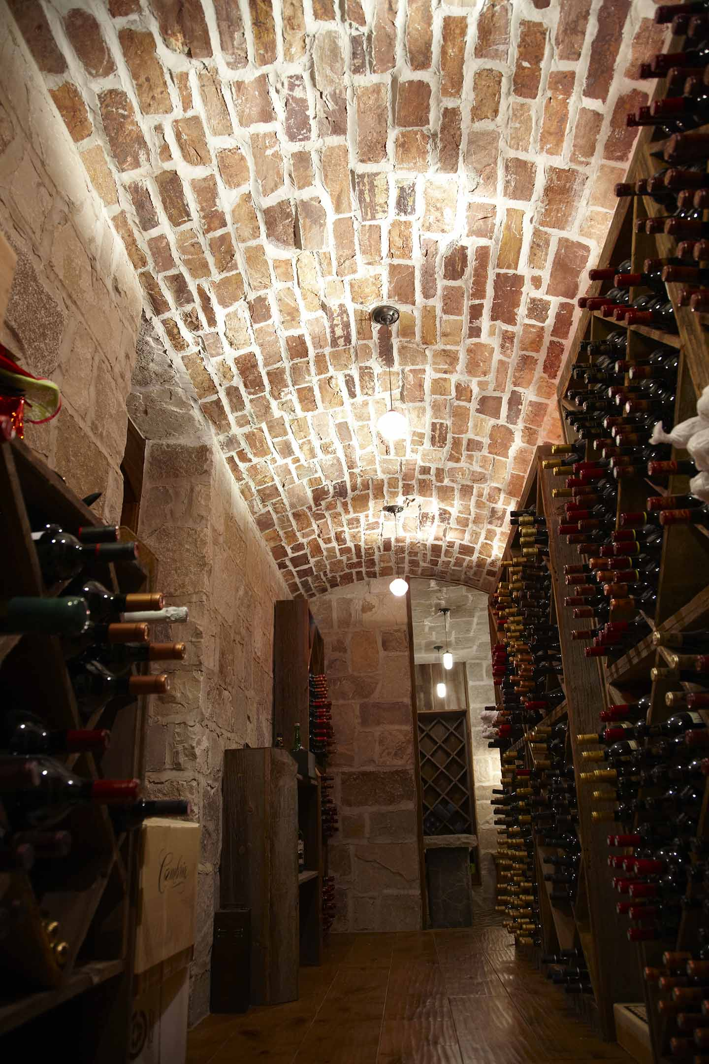 Home wine cellars what s a luxury custom home without for Luxury home wine cellars