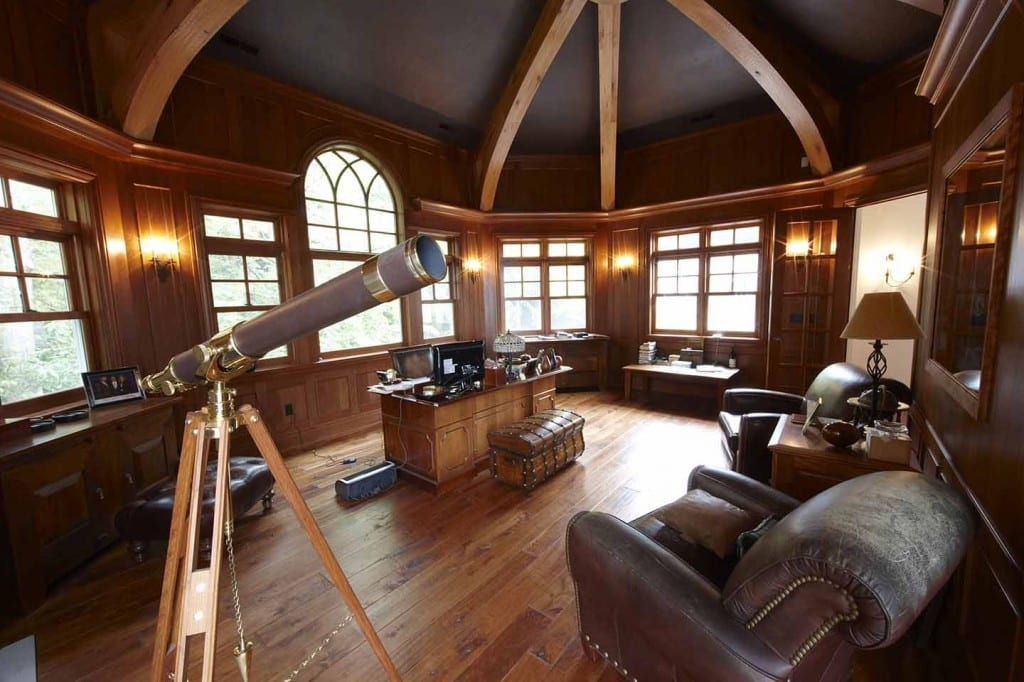 Colby Construction prides itself on making each custom lake home, as special as this lake country home. With wood being the emphasis, a stoic desk is surrounded by aged leather chairs and surveying equipment.