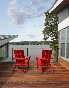 Getting Outdoors in Your Custom Home - Patio with 2 red chairs